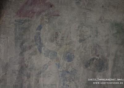Turm und Burgzinnen symbolisieren die mittelalterliche höfische Kulisse. Rechts im Bild das Herrscherpaar mit dem Landgrafen Hermann I. von Thüringen und seiner Frau Sophie, die ihren Arm erhebt und damit in das Geschehen eingreift. Hintergrund ist, dass der Dichter Heinrich von Ofterdingen im Sängerwettstreit unterlag und dem Henker übergeben werden sollte. Er besaß die Unhöflichkeit und pries nicht den Gastgeber, sondern allein den eigenen Landesherrn. Die Landgräfin bewahrte ihn schließlich vor der drohenden Hinrichtung nachdem er sie in Todesangst um Hilfe bat.  Im Bild sind außerdem eine junge Frau zu sehen, die dem Paar zugewandt ist. Unten rechts ist der Kopf einer weiteren Figur erkennbar. Die Darstellungsweise der Figuren hat keine Ähnlichkeiten mit der mittelalterlichen Vorlage aus dem Codex Manesse.  Text: Uta Fischer © 2014, All rights reserved. Foto: © WILDFISCH