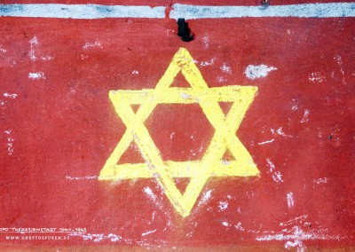 Cultural Activities: The yellow Star of David (Mogen David) on a red background is a theatre decoration that still adorns the attic entrance today. In Theresienstadt many theatre performances held in Czech and German took place, at first still in secret. There are hardly any traces left like this one.